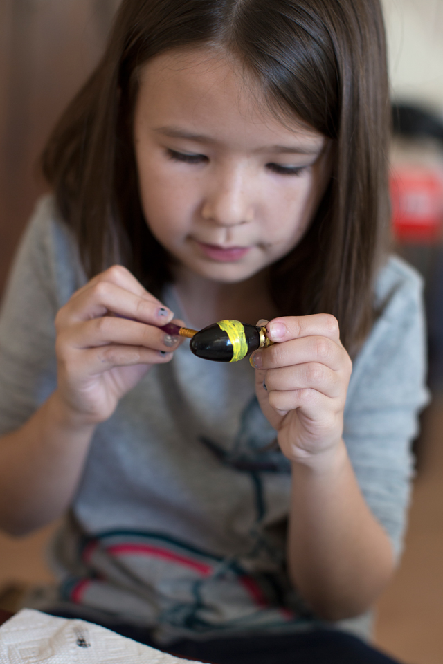 Painting the yellow strips on the bee ornament.
